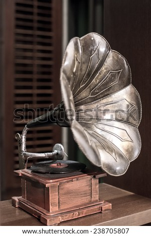 retro old gramophone with horn speaker - stock photo