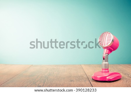 Retro old microphone from 60s front mint green background. Vintage style filtered photo - stock photo