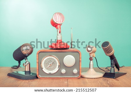 Retro old style microphones and radio front mint green background - stock photo