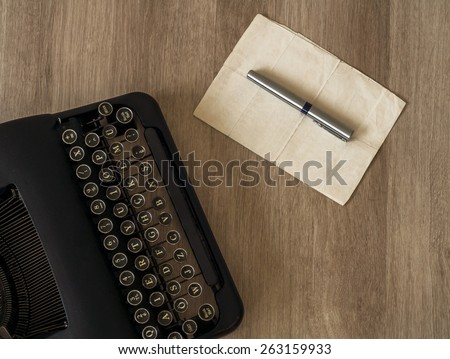 Retro old typewriter with paper notes. - stock photo