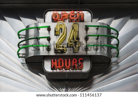 Retro Open 24 Hours neon illuminated sign - stock photo