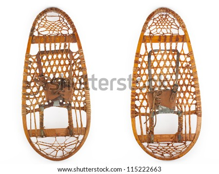 retro pair of snowshoes isolated on white - stock photo