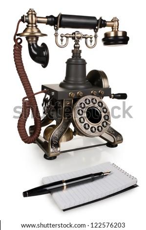 Retro Phone, Pen and Notepad - Vintage Telephone Set isolated on White Background - stock photo