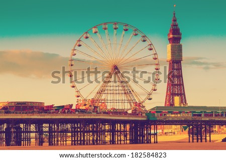 Retro Photo Filter Effect Blackpool Tower and Central Pier Ferris Wheel, Lancashire, UK - stock photo