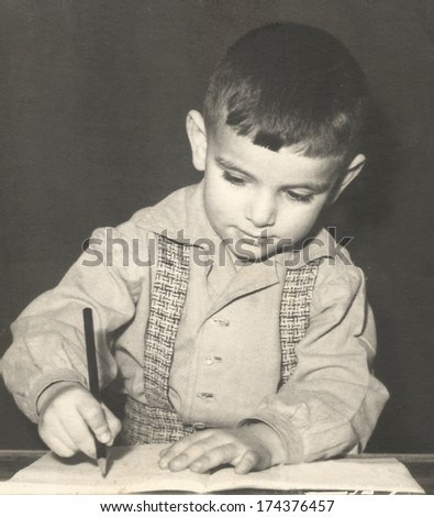 Retro photo of a young boy - stock photo