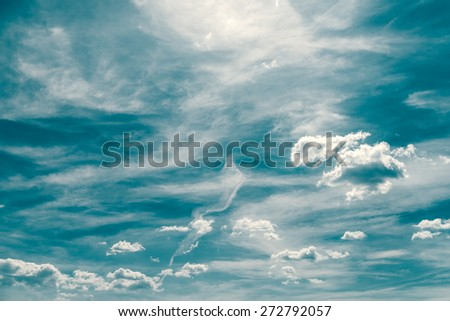 Retro Photo Of Blue Summer Sky And Clouds - stock photo