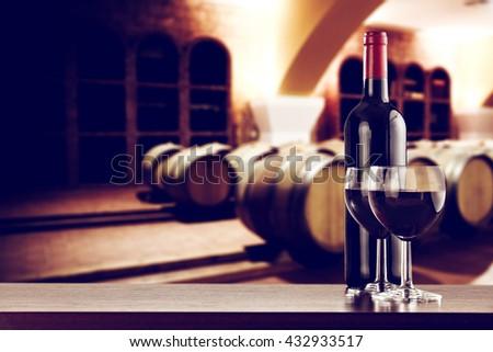 retro photo of few barrels and dark desk and wine  - stock photo