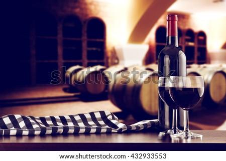 retro photo of few barrels and dark top and wine  - stock photo