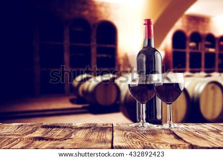 retro photo of few barrels and wine  - stock photo