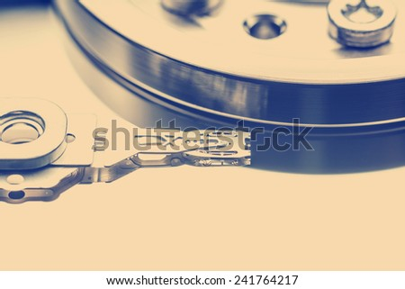 Retro Photo Of Old Hard Disk Drive Inside - stock photo