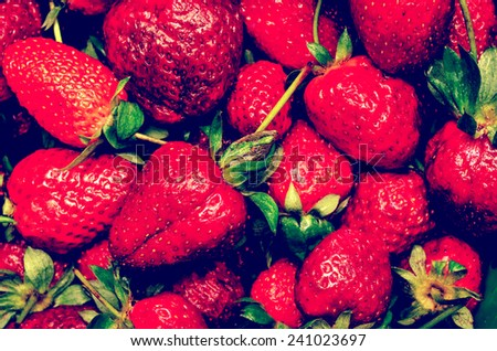 Retro Photo Of Red Summer Strawberry Fruits In Market Display - stock photo