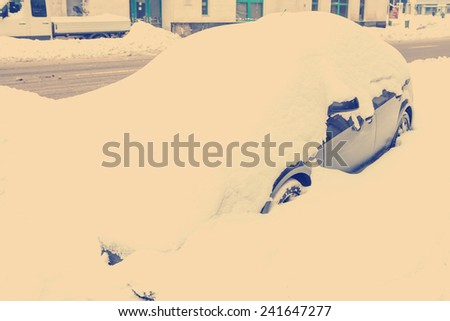 Retro Photo Of Snow Covered Car In Heavy Winter - stock photo