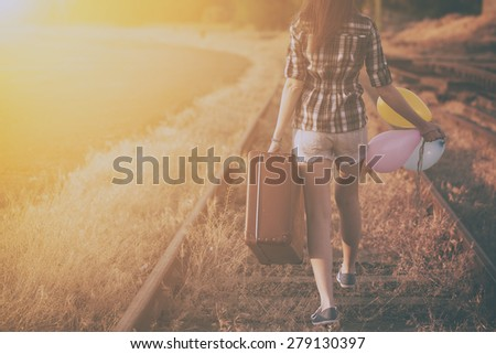 Retro photo of traveler woman - stock photo
