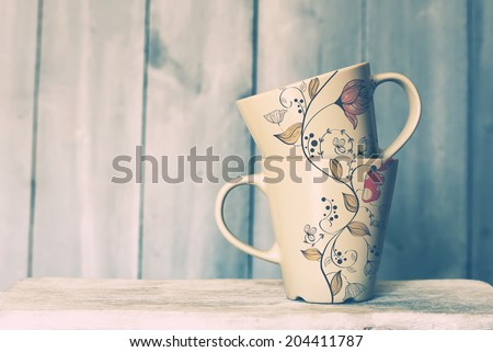Retro photo of two cute tea  mugs - stock photo
