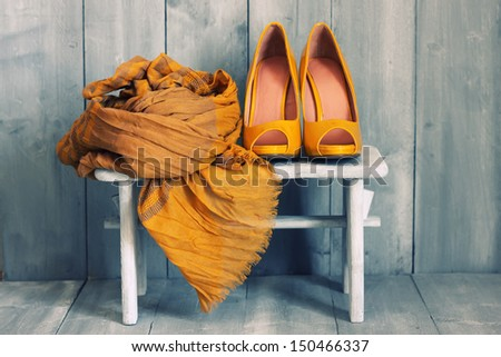 Retro photo of yellow shoes - stock photo