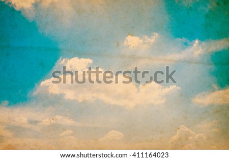 Retro photo with noisy texture. Blue sky with clouds. The sky with clouds for background. Nature background - stock photo