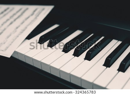 Retro piano with notes, music background - stock photo