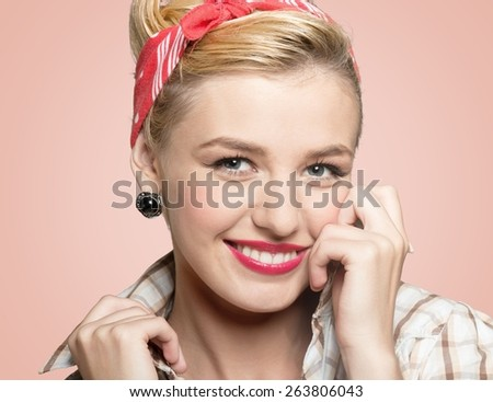 Retro. Pin-up style portrait of surprised blonde woman sepia toned - stock photo