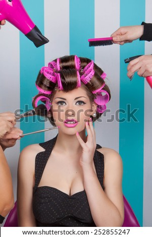 retro pin up woman getting pampered  in beauty salon - stock photo