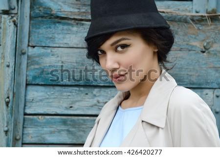 Retro portrait of a beautiful woman. Vintage style. Outdoor fashion photo. Female beauty. - stock photo