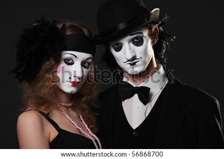 retro portrait of mimes over black background - stock photo