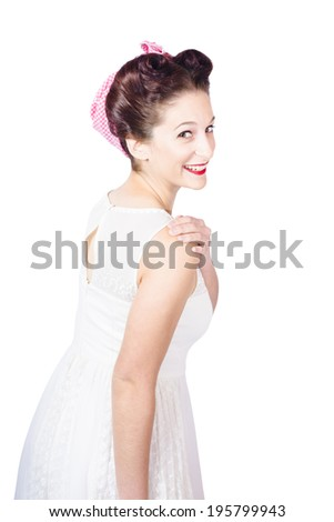 Retro portrait of young happy sexy woman wearing red lipstick and pin-up girl dress walking into white wall copyspace - stock photo