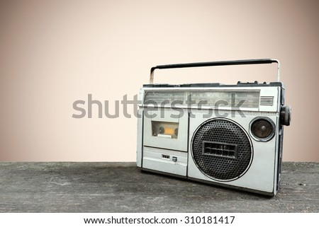 Retro radio and cassette stereo recorder on pastel background - stock photo