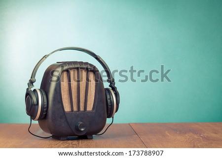 Retro radio and headphones conceptual photo - stock photo