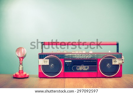 Retro radio cassette recorder from 80s and microphone front mint green background. Vintage old instagram style filtered photo - stock photo