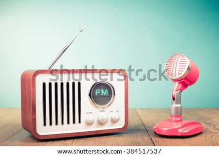 Retro radio, old microphone from 60s front mint green background. Vintage style filtered photo - stock photo