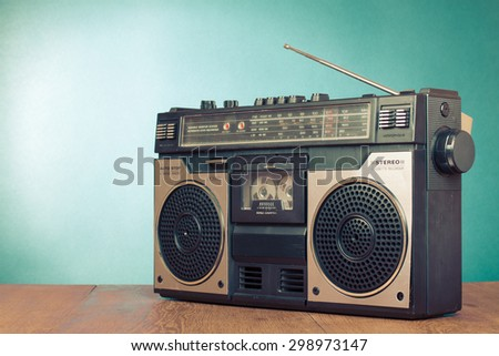 Retro radio recorder from 70s front turquoise background. Old instagram style filtered photo - stock photo