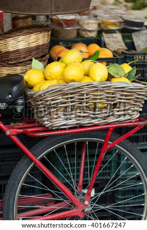 retro red bike in fruit market Campo dei Fiori in Rome - stock photo