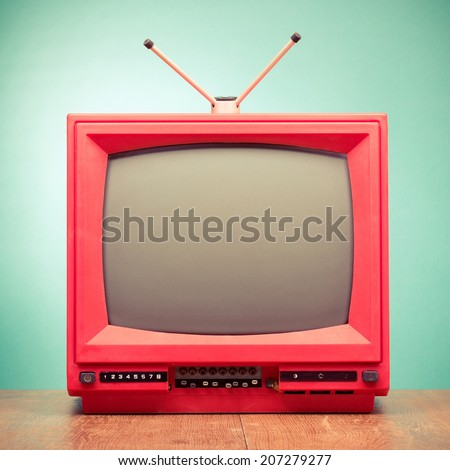 Retro red old television from 80s front mint green wall background - stock photo