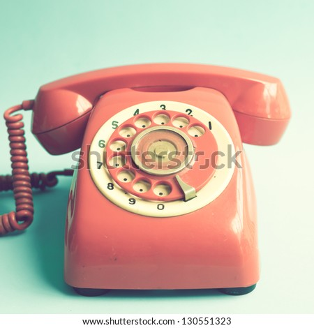 Retro Red Telephone on Blue Background - stock photo