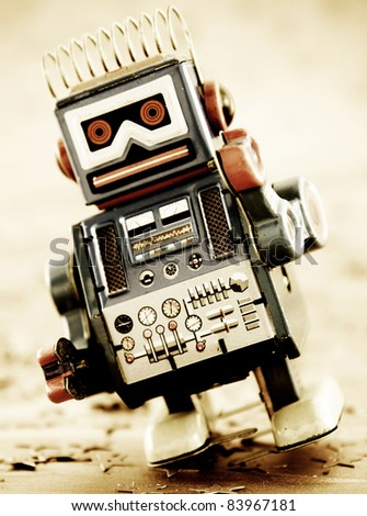 retro robot on gold - stock photo