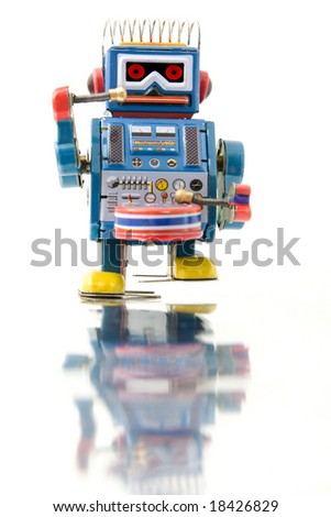 retro robot toy and reflection - stock photo