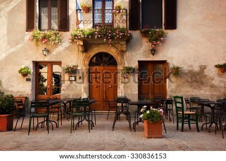 Retro romantic restaurant, cafe in a small Italian town. Vintage Italy, outdoor trattoria - stock photo