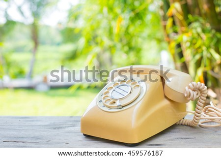 Retro rotary telephone, Classic vintage home phone on wood table - stock photo