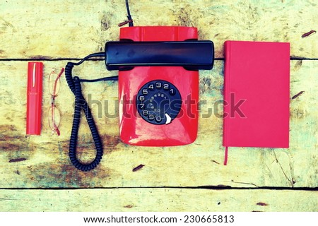 Retro rotary telephone on a wooden background - stock photo