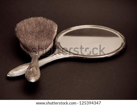 retro silver mirror and comb - stock photo
