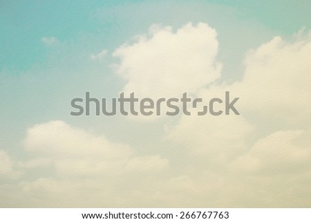 Retro sky with moving soft clouds on watercolor paper texture   - stock photo
