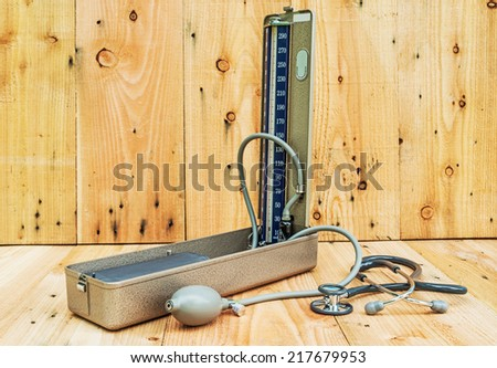 Retro sphygmomanometer and stethoscope  - stock photo
