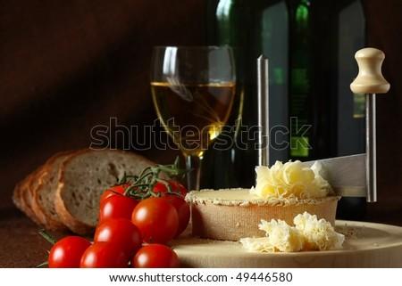 Retro Still Life - Swiss Cheese Specialty - Tete De Moine on the scraper Girolle, DOF on cheese - stock photo