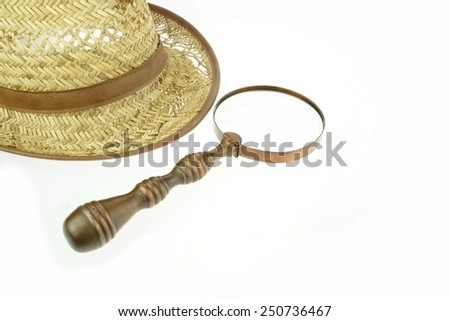 Retro Straw Hat and  Magnifying Glass Isolated on White Background - stock photo