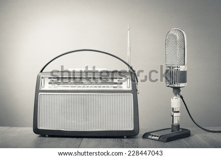 Retro studio ribbon microphone and radio receiver. Vintage old style greyscale photo - stock photo
