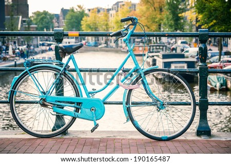 Retro style bicycle in Amsterdam, Netherlands - stock photo
