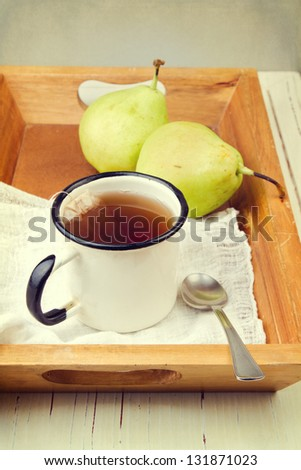 Retro style composition with tea and pears - stock photo