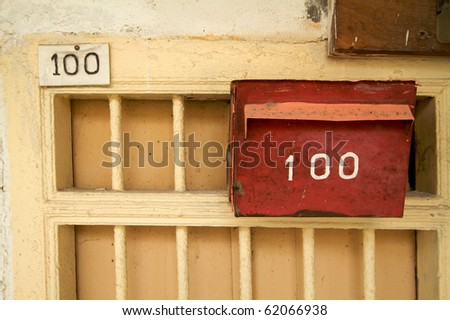 Retro style letterbox with number on wall - stock photo