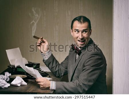 Retro style man typing on a typewriter - stock photo