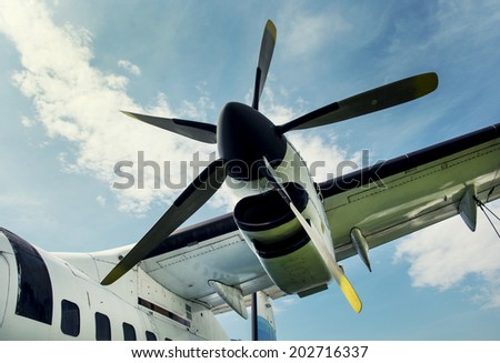 Retro style of engine propeller aircraft. - stock photo